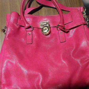 Hot Pink Michael Kors hand bag.